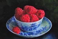Raspberries in a blue bowl